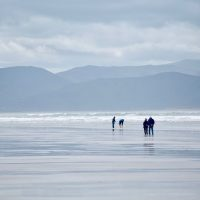 Wander the white sands of Inch Beach on the Dingle Way